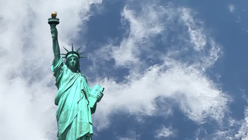 Statue of Liberty on the background of sky with clouds running. | Shutterstock HD Video #4125046