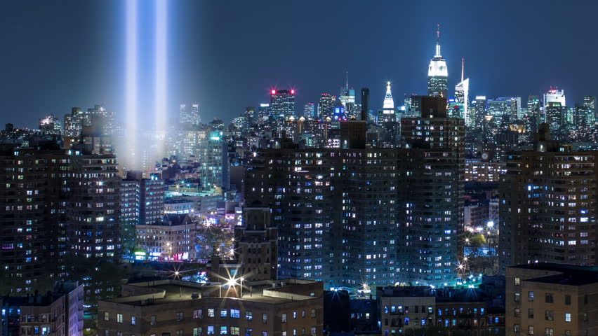 911 Lights in New York City - Empire State Building and Manhattan Skyline at Night in NYC with September 11th World Trade Center Memorial Beams