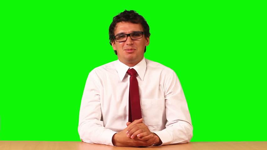 Businessman speaking on green screen