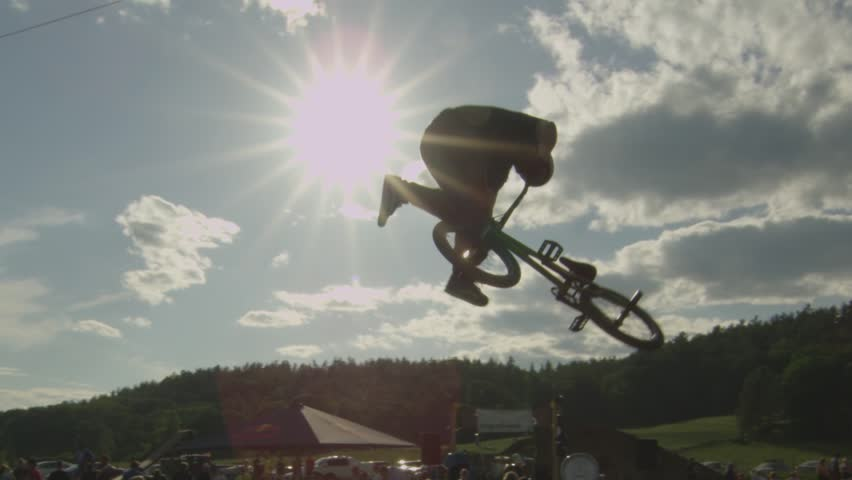 BMXer extreme sport 360 Tailwhip Trick on Dirt Jump