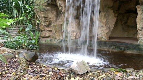 Water Splashing  Down A Man-made Waterfall