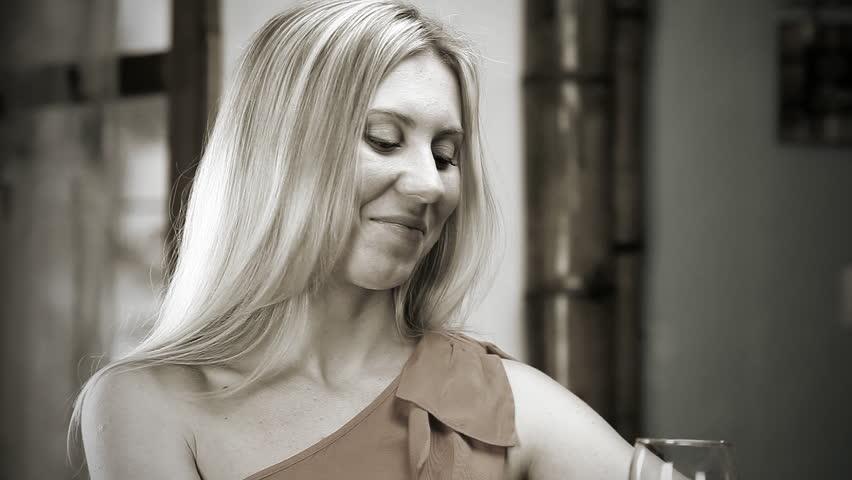 Beautiful blond woman drinks red wine in the bar | Shutterstock HD Video #4189342