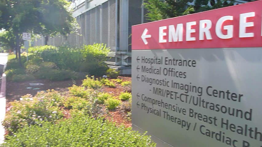 WASHINGTON HOSPITAL BUILDING - CIRCA 2013: Hospital entrance exterior with sign pointing to entrance.