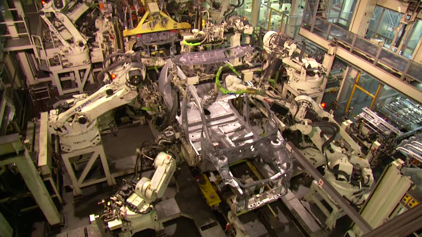 Robots are welding in automobile factory. assemble a car in fast motion.