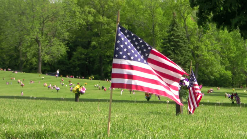 US flags waving over veteran graves on Memorial Day