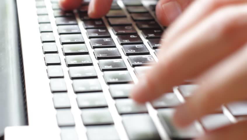 Man hands typing on a computer keyboard | Shutterstock HD Video #4207399