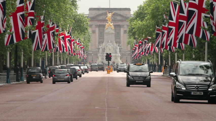 LONDON - JUNE 12:Traffic drives down The Mall towards Buckingham Palace with British flags along the road in preparation for the Trooping of the Colour on June 12, 2013 in London.  | Shutterstock HD Video #4216762