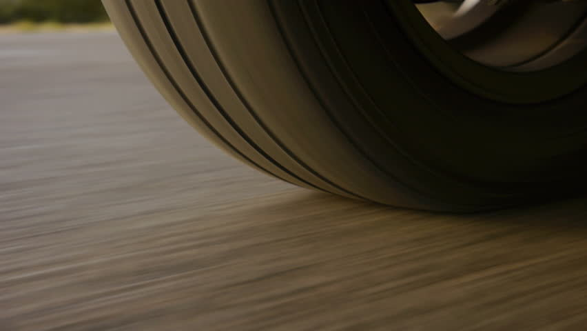 Car wheel spinning POV - Point of View, day country side.  | Shutterstock HD Video #4218385