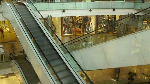 Shopping Mall Escalators Time-Lapse. People going up and down. Walking & Shopping.