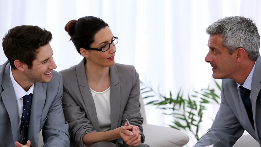 Group of business people having a meeting in the sitting room | Shutterstock HD Video #4227484