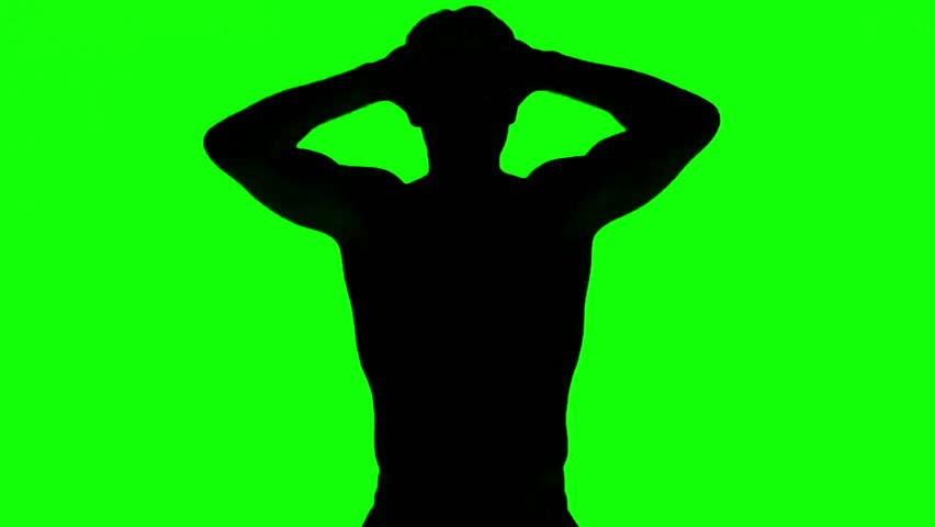 Silhouette of a man tensing arms on green screen in slow motion | Shutterstock HD Video #4227826