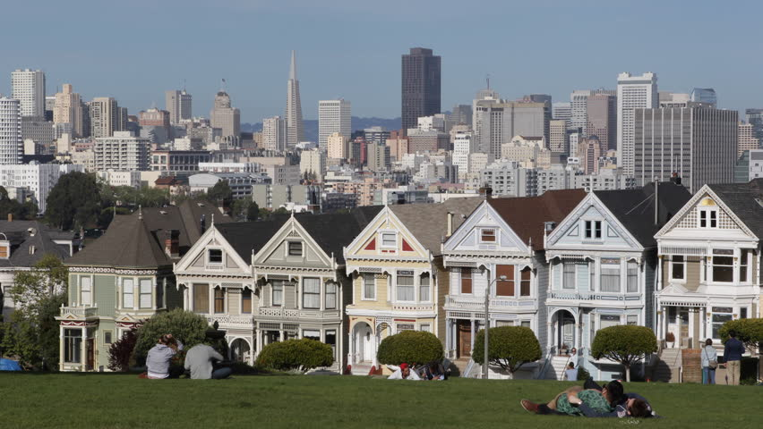 SAN FRANCISCO, USA - APRIL 2, 2013 Famous Victorian Row Houses in San Francisco with skyline, Painted Ladies, Touristic Attraction, Alamo Square