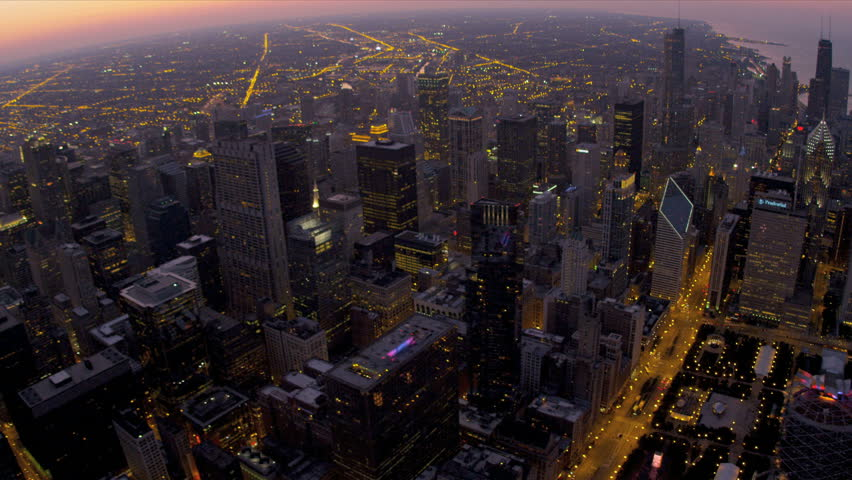 Aerial overhead illuminated sunset view Sears Tower, avenues of light, downtown Chicago, Illinois, USA, shot on RED EPIC | Shutterstock HD Video #4247072