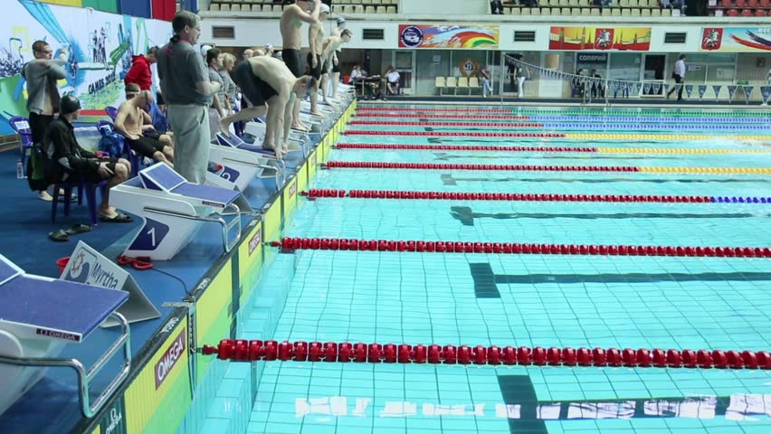 MOSCOW - APR 20: Sportsmen jump into water during relay race of swimming in pool at Championship of Russia in Olympic Sports complex on April 20, 2012 in Moscow, Russia