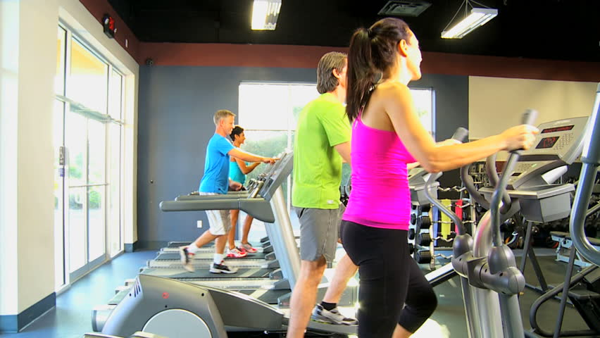 Multi ethnic gym members exercising on modern cross walkers and treadmills as part of healthy lifestyle | Shutterstock HD Video #4267934
