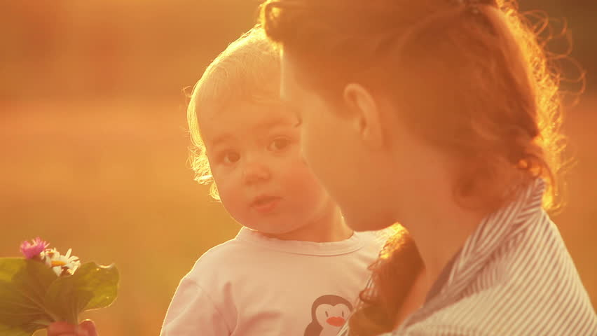 Happy mother playing with little daughter at sunset (close-up) | Shutterstock HD Video #4271630