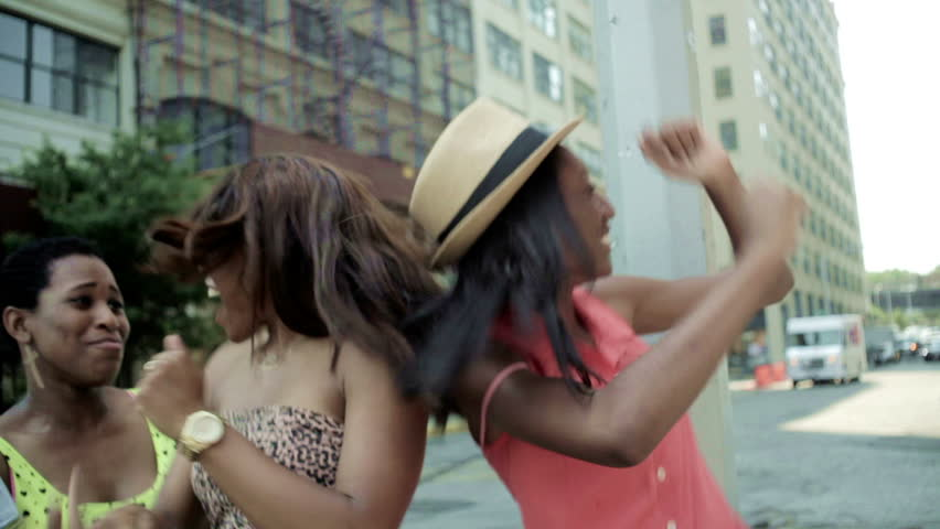 3 teenage girls partying outdoor having a party in the street dancing having fun smiling and happy outside on a sunny day | Shutterstock HD Video #4285337