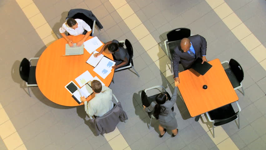 Overhead view of multi ethnic business groups with clients holding meetings to future plan projects | Shutterstock HD Video #4286342