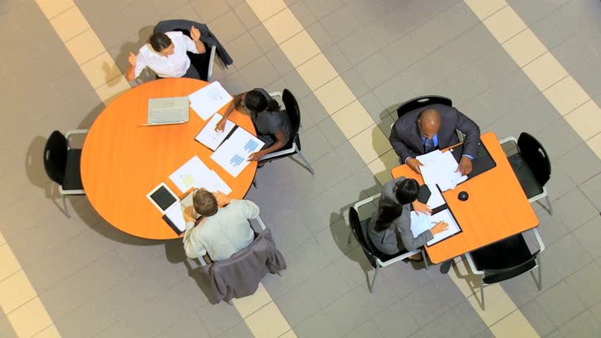 Overhead view of groups of multi ethnic business people holding meetings | Shutterstock HD Video #4286405