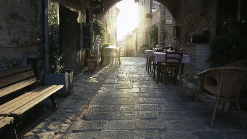 Outdoors restaurant on medieval town at sunset #4290671
