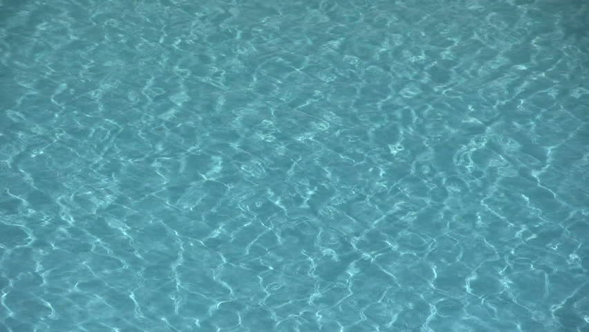Water ripples in an outdoor swimming pool.