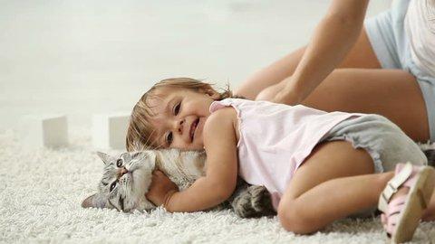 Cute girl cuddling with her furry friend