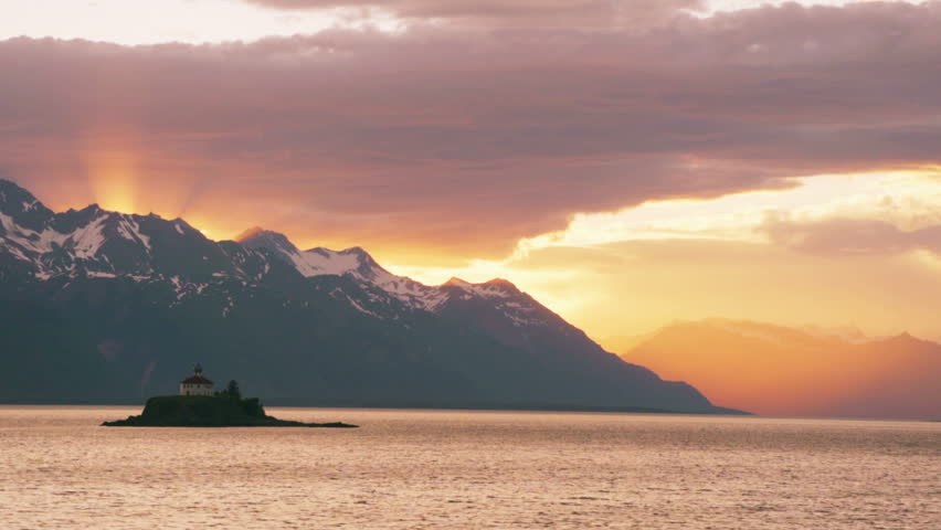 Landscape view from ferry between Juneau and Haines of island lighthouse and
