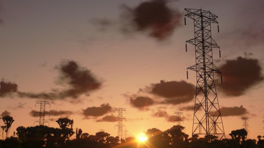 Electricity pillars, timelapse sunrise
