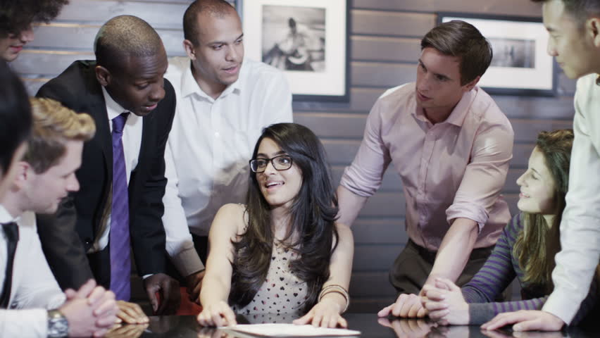 Happy and enthusiastic multi ethnic business group are listening and exchanging ideas in a meeting.  | Shutterstock HD Video #4388108