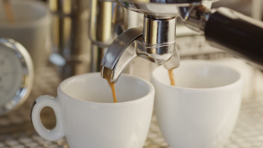 Two Cups of Espresso Being Poured from a Professional Espresso Machine. Close-Up. Shot on RED Digital Cinema Camera in 4K, so you can easily crop, rotate and zoom, without losing quality! | Shutterstock HD Video #4388717
