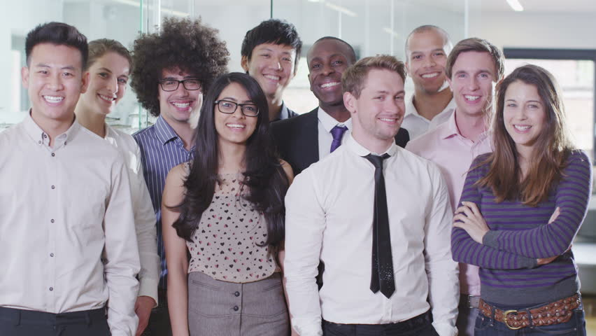 Portrait of a happy and casual young creative business team smiling and having fun together.  | Shutterstock HD Video #4389014