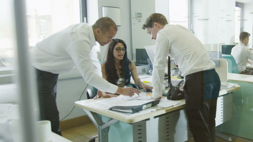 Young creative business team working together in a light contemporary office.  | Shutterstock HD Video #4389539