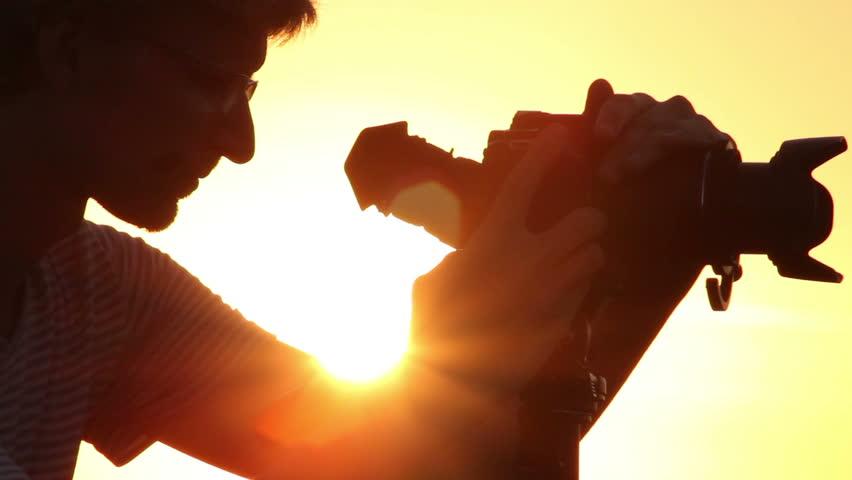 Successful shot by young male photo video shooting tripod camera   Shutterstock HD Video #4399082