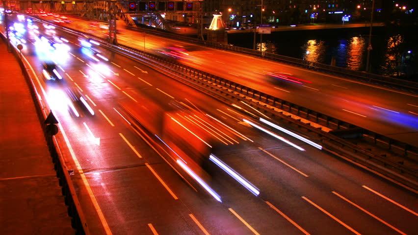 Night city traffic on a freeway, time-lapse. | Shutterstock HD Video #4407125