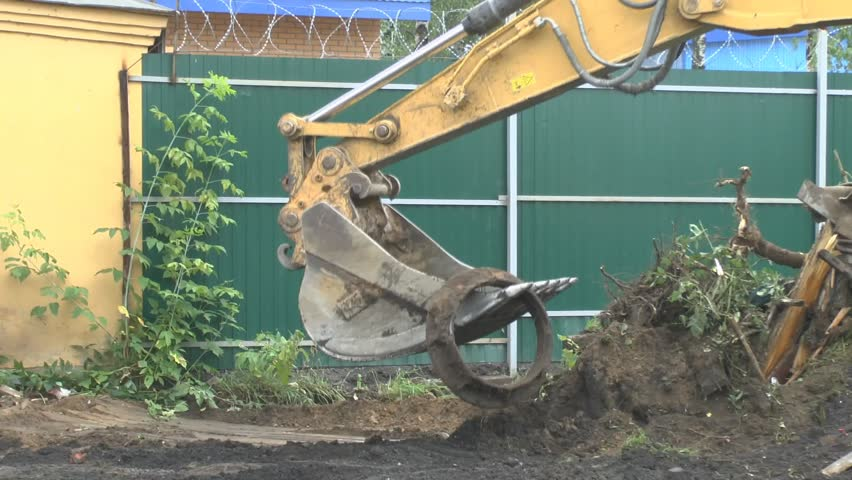 Excavator is digging the ground | Shutterstock HD Video #4415570