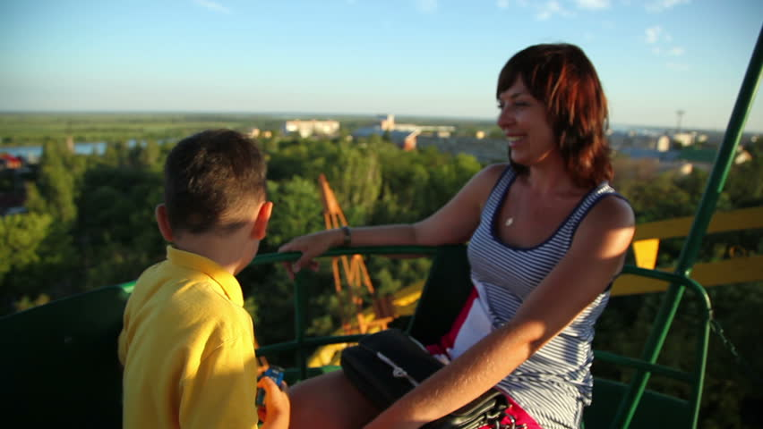 Little boy with his mother on the Ferris wheel 2 | Shutterstock HD Video #4417817