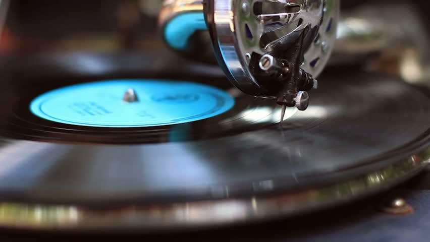 Retro gramophone playing, big fashionable needle scrapes record making music