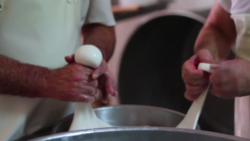 A shot showing how the mozzarella cheese is made | Shutterstock HD Video #4425149