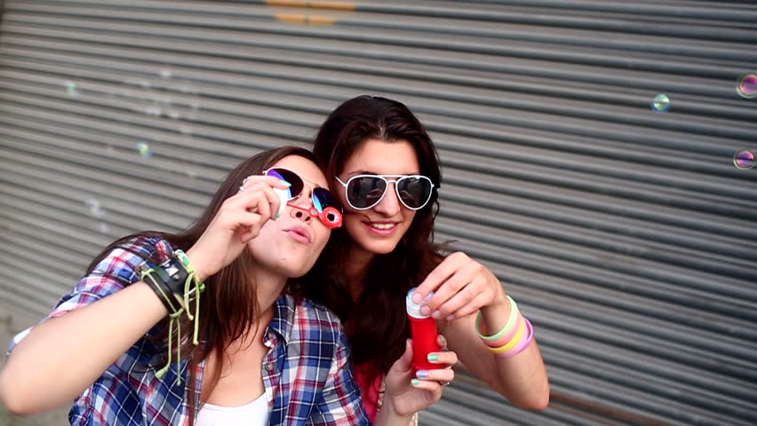Teenage hipster friends cheerfully making soap bubbles | Shutterstock HD Video #4435736