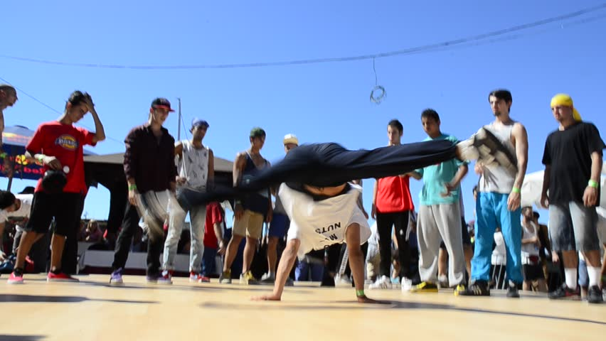 VIGO, SPAIN - AUGUST 10: B-Boying crews warmup at the O Marisquino XIII on august 10, 2013 in Vigo, Spain.