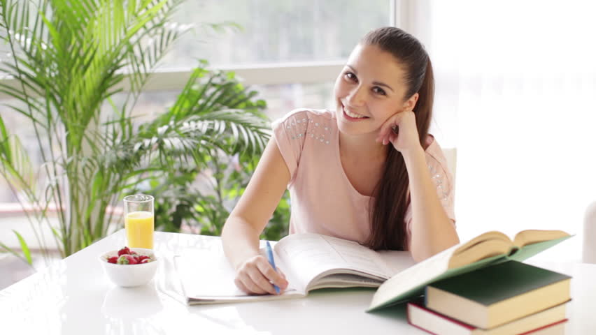 Student Girl Sitting At Table Stock Footage Video 100 Royalty Free 4463978 Shutterstock