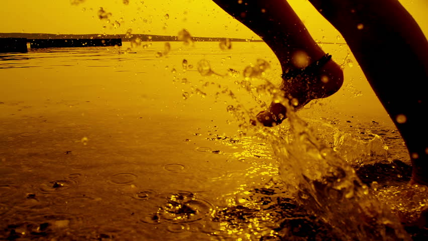 SLOW MOTION: Girl running in shallow water at sunset | Shutterstock HD Video #4465301
