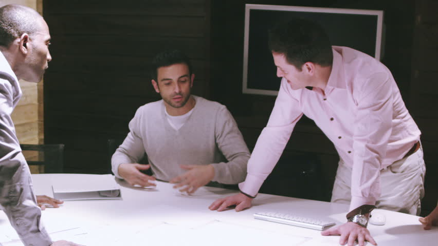 Portrait of young business team at work. Bright contemporary small creative business. Casual young people in new creative business office or architects company. | Shutterstock HD Video #4477739