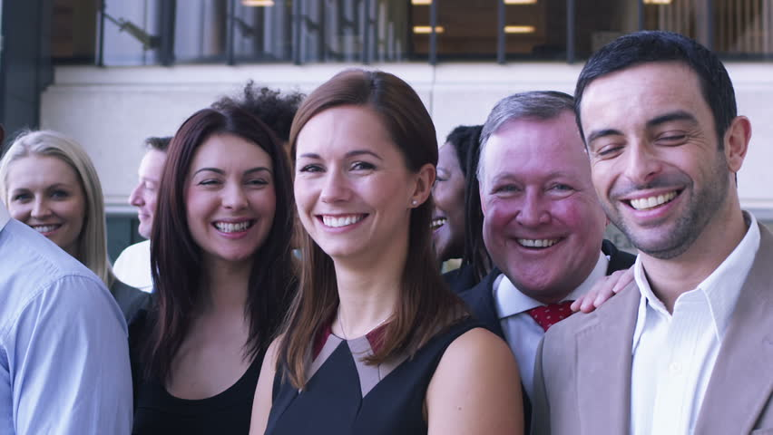 Portrait of young diverse business team. Large business organization in corporate building.