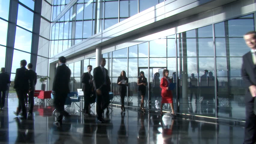 Business partners meet and shake hands in large contemporary corporate building. High quality HD video footage | Shutterstock HD Video #4479497