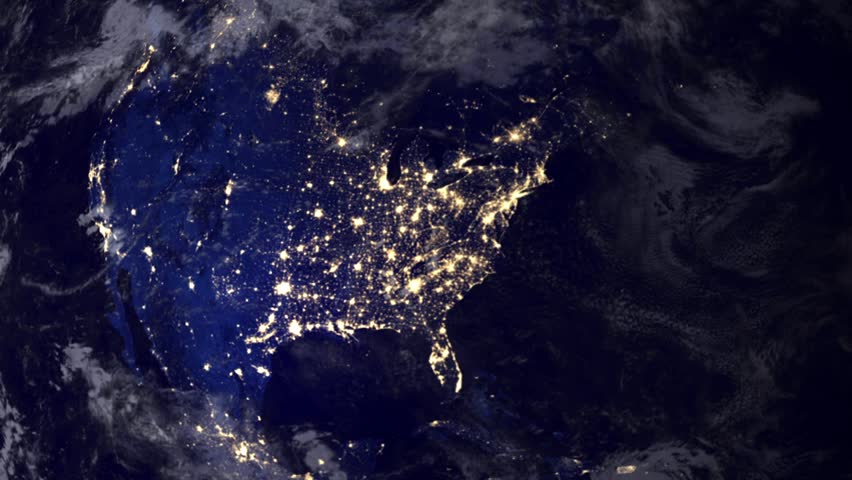 Telecommunication satellite over earth North America night space view.. Cinema quality animation. Focus changes from earth to satellite. Satellite orbiting the Earth. NASA PD image used.