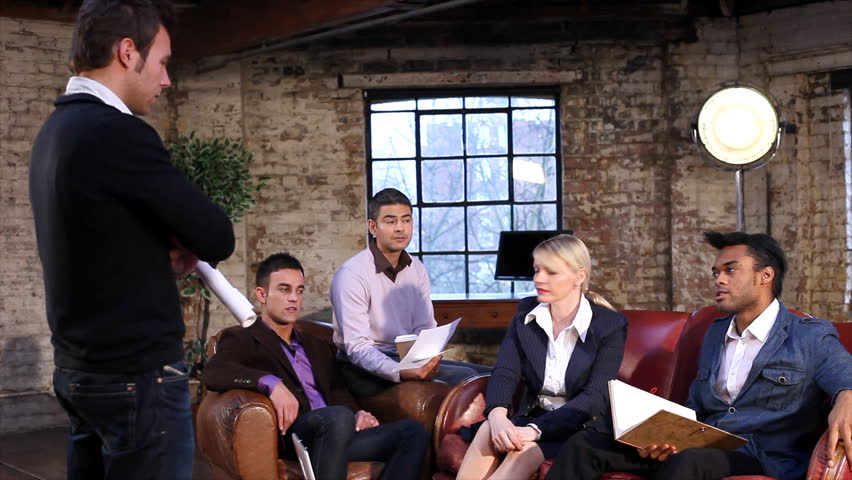 Group of young professional business people in relaxed discussion. Creative business team on sofas. | Shutterstock HD Video #4489058