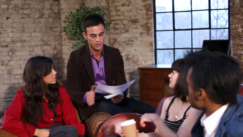 Group of young professional business people in relaxed discussion. Small creative business team planning projects on sofas. | Shutterstock HD Video #4489142