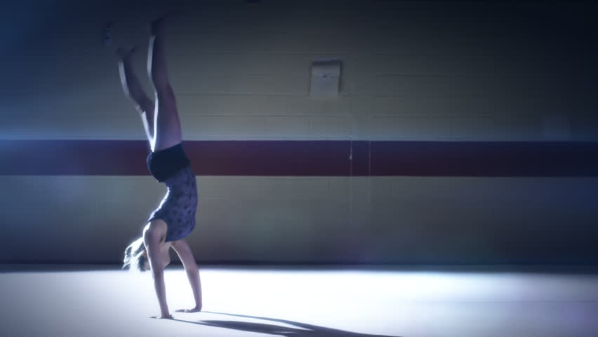 Gymnast floor work. Olympics sport in contemporary setting. Slow motion Shot on RED Epic at 240FPS