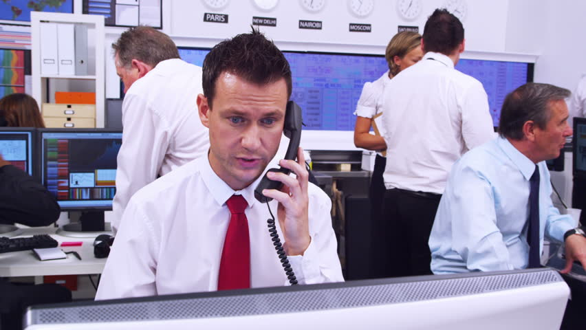 Financial business team of Stockbrokers trading. Could be large bank corporation or independent stocks and shares firm. Filmed on RED ONE Digital Cinema Camera with 17-50mm 35mm RED Lens. Jib motion. | Shutterstock HD Video #4497977
